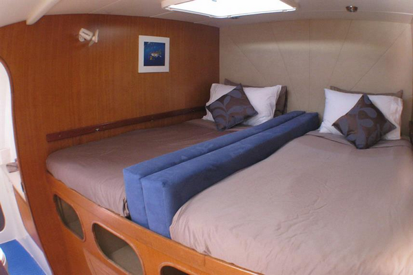 Features of Australia Shore Thing Catamaran cabin and deck - twin cabin