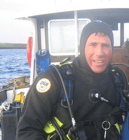 Russell Bowyer scuba diving expert in DUI dry suit before a scuba dive in the UK
