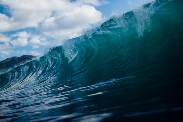 What are the dangers caused by wave height as a result of too much wind for diving from a boat