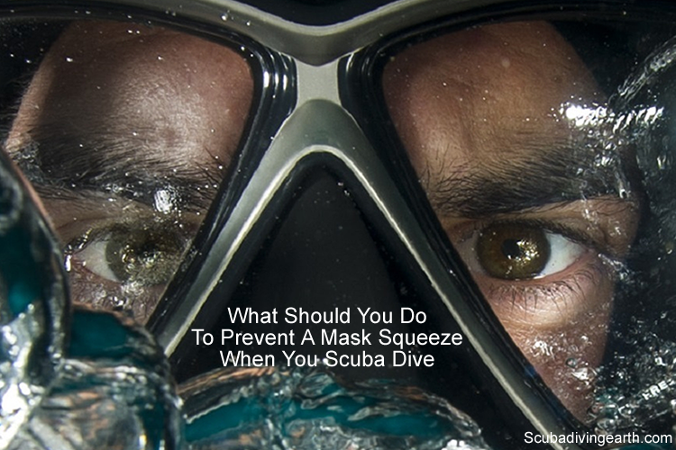 What should you do to prevent a mask squeeze when you scuba dive